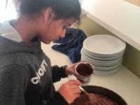 A girl makes a cake