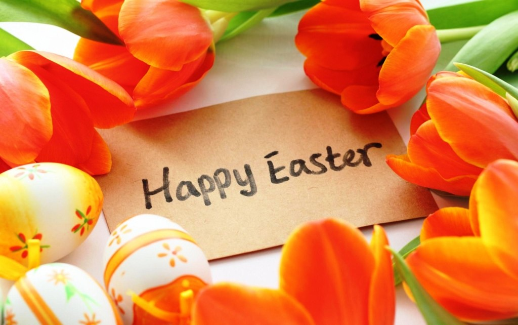 orange-tulips-flowers-and-eggs-with-happy-easter-greeting-words-1500x940