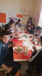 Children eating lamb