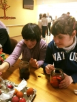 GS - 2 girls coloring eggs