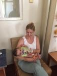 Jody feeding a baby