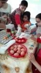 Kids colouring eggs