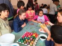 Roman - kids coloring eggs